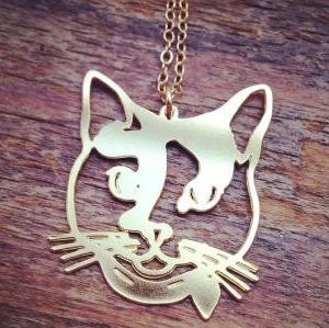 9 + Evelyn M curated cat designs + Island Woman